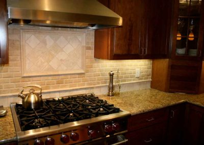 Granite Kitchen Countertop and Travertine Backsplash in Lafayett