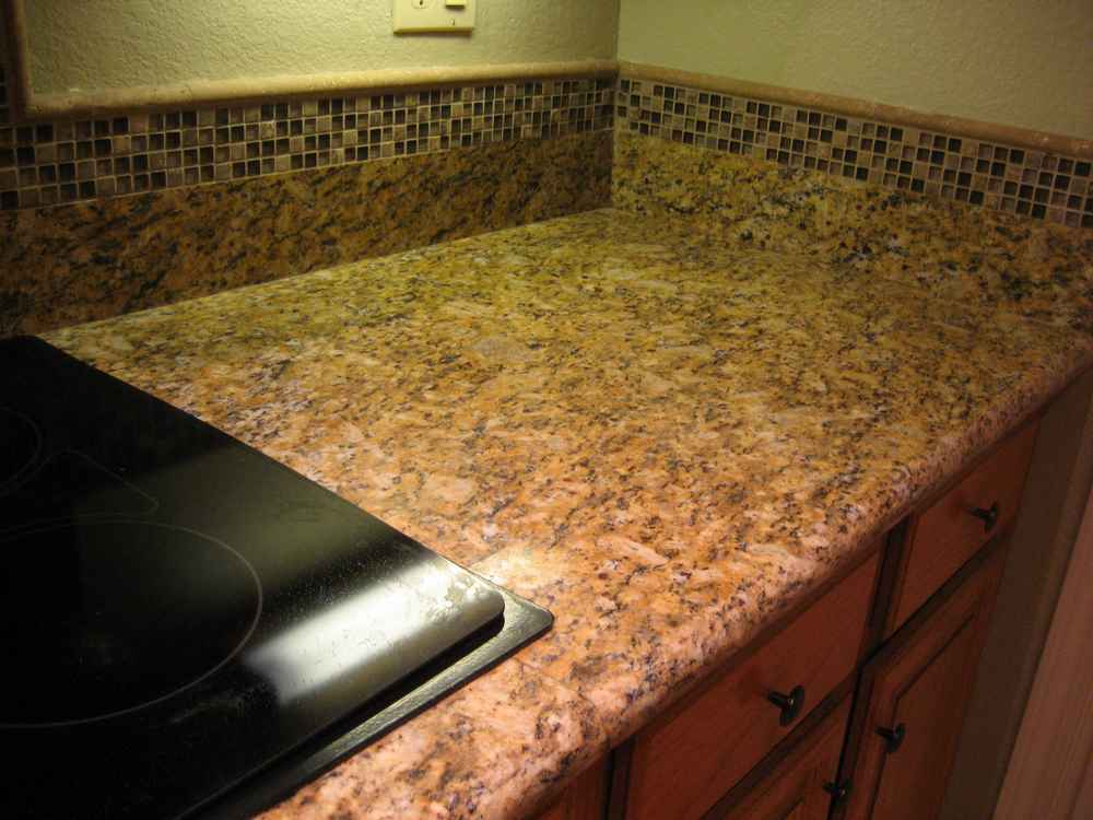 Nonabsorbent stick resistant surface will corian for Corian countertop price